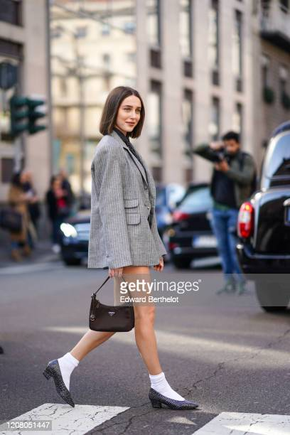 Mary Leest wears a gray oversized jacket a Prada bag white socks pointy shoes a tie outside Ermanno Scervino during Milan Fashion Week Fall/Winter...