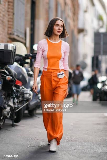Mary Leest wears a pink and orange top, orange pants, white shoes, outside the Blumarine show during Milan Fashion Week Spring/Summer 2020 on...