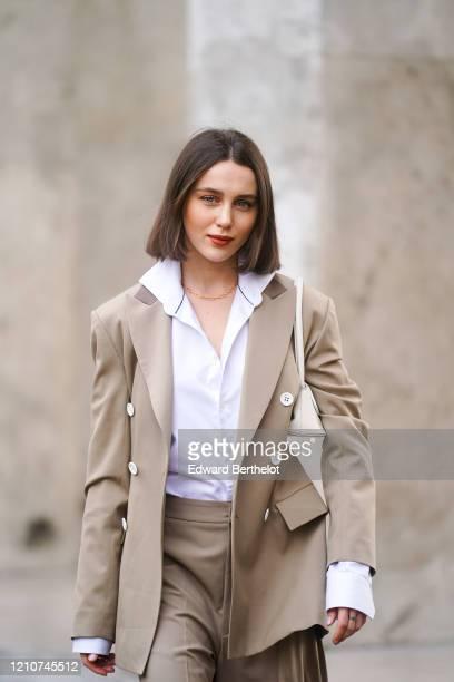 Mary Leest wears a white shirt, a beige oversized jacket, shorts, outside Gauchere, during Paris Fashion Week - Womenswear Fall/Winter 2020/2021 on...