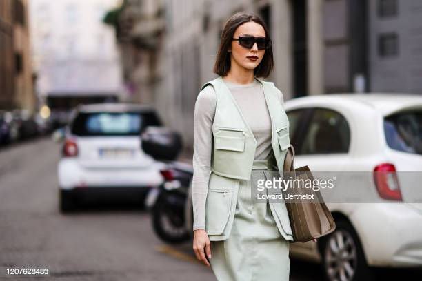 Mary Leest wears sunglasses a pale green jacket a gray top a skirt a brown leather bag outside Max Mara during Milan Fashion Week Fall/Winter...
