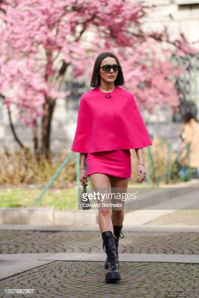 Mary Leest wears sunglasses, a pink cape/top, a skirt, a bag, outside Koche x Pucci, during Milan Fashion Week Fall/Winter 2020-2021 on February 20,...