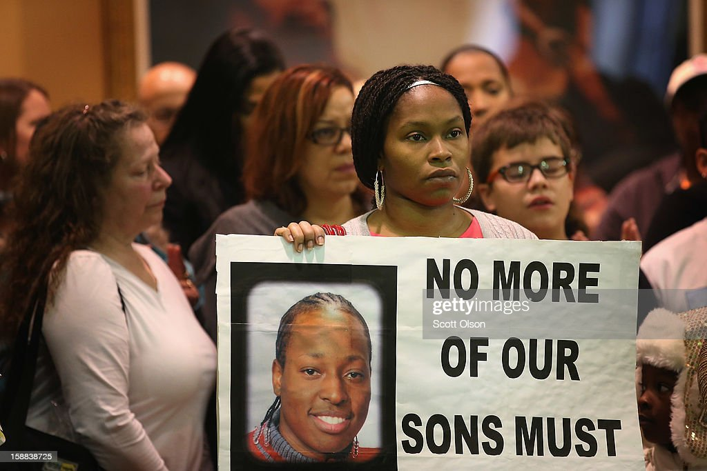 Mary Long holds a picture of her son Eric Williams during a press conference she attended with other family members of murder victims on December 31, 2012 in Chicago, Illinois. Williams was 25-years-old when he was murdered on March 12, 2012.