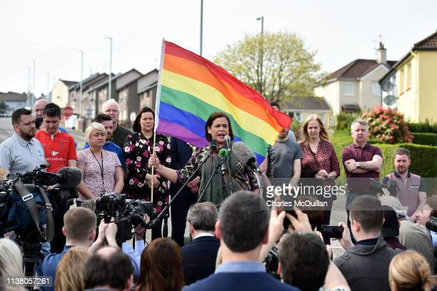 Mary Lou McDonald Leader of Sinn Fein holds up a rainbow flag as she speaks at a rally for journalist and author Lyra McKee near the scene of her...