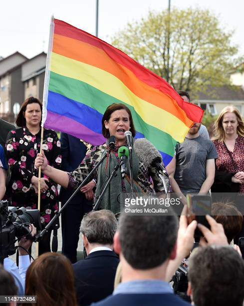 Mary Lou McDonald, Leader of Sinn Fein holds up a rainbow flag as she speaks at a rally for journalist and author Lyra McKee near the scene of her...