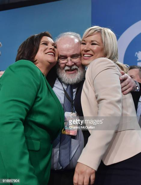 Mary Lou McDonald , newly appointed President of Sinn Fein and Michelle O'Neill , newly elected vice President are hugged by Francie Molloy at the...