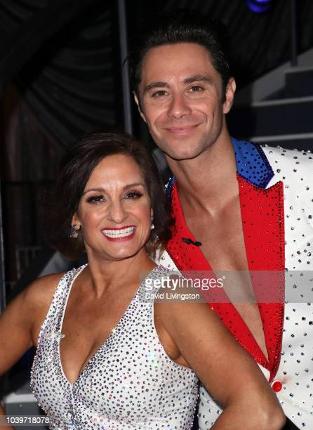 """Mary Lou Retton and Sasha Farber pose at """"Dancing with the Stars"""" Season 27 at CBS Televison City on September 24, 2018 in Los Angeles, California."""