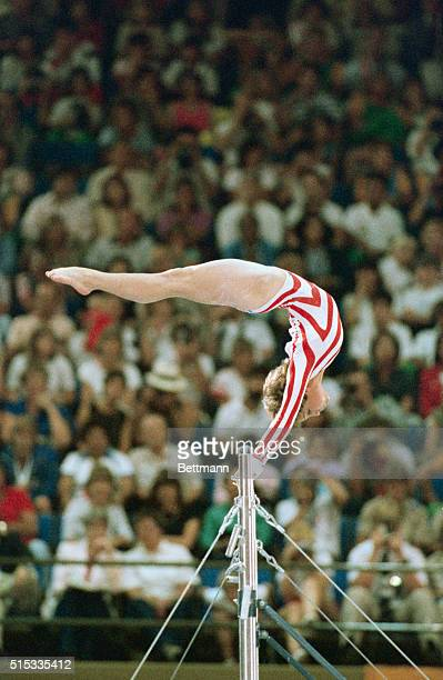 Mary Lou Retton performing on the uneven bars in Los Angeles