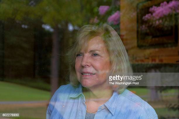 Mary Lou Yeager looks out from a rear wind of her house that backs up to the golf course just a few houses away from where John Hinkley' Jr's mother...
