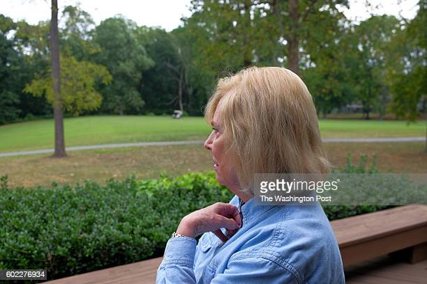 Mary Lou Yeager looks out from her house that backs up to the golf course just a few houses away from where John Hinkley' Jr's mother lives in the...