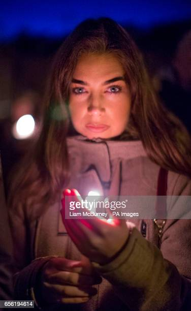 Mary Louise Kelly attends a vigil at the former site of the Andersontown Police Station in Belfast after Northern Ireland's former deputy first...