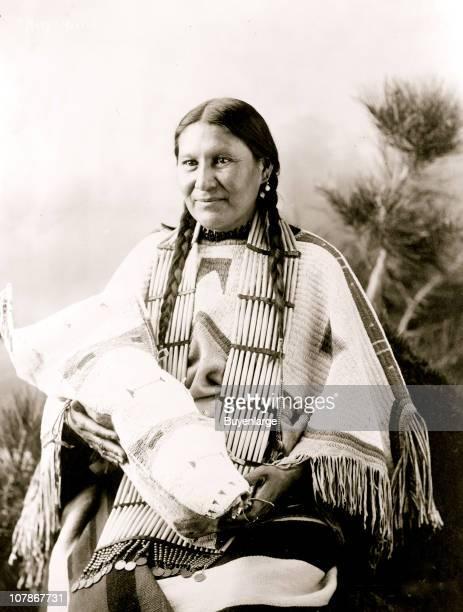 Mary Martin Indian threequarter length portrait seated facing slightly left holding cradleboard 1900