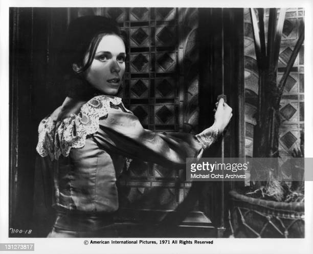 Mary Maude by stained glass window in a scene from the film 'The House That Screamed' 1971