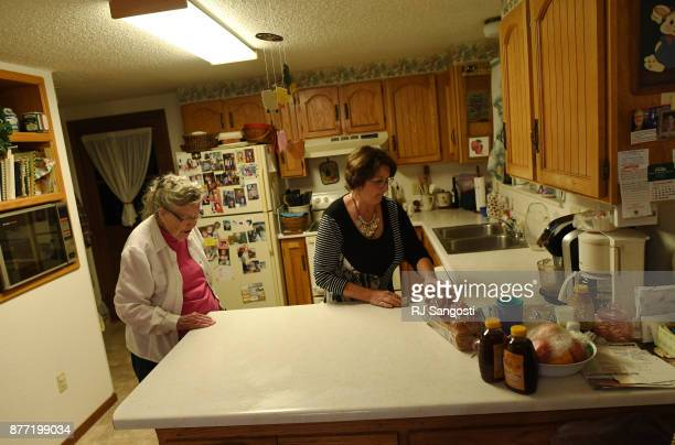Mary May Gourley comes into her kitchen as her daughter Marcella Swanson helps clean up on November 13 2017 in Two Buttes Colorado Mary May and her...