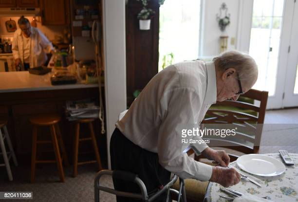 Mary May Gourley left makes supper as her husband James sets the table on July 20 2017 in Two Buttes Colorado The two have been married over 70 years...