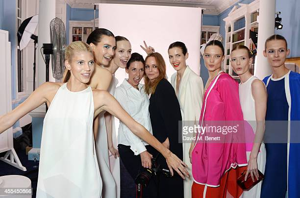 Mary McCartney and Stella McCartney pose with models at attends The London 2014 Stella McCartney Green Carpet Collection during London Fashion Week...