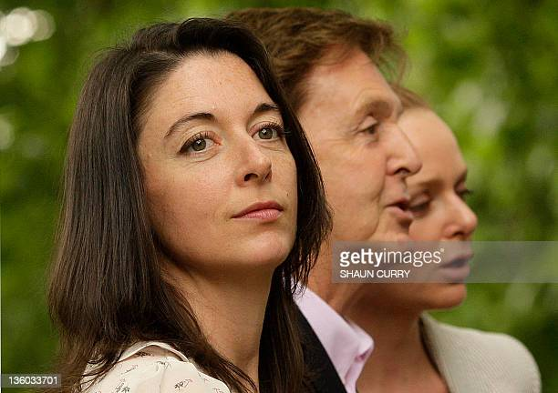Mary McCartney poses for pictures with her father Sir Paul McCartney and sister Stella as they arrive for the launch of 'Meat Free Mondays' in...