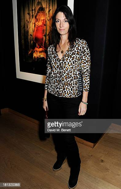 Mary McCartney poses in front of her photograph at a private view of 'Kate Moss The Collection' at Christie's King Street on September 20 2013 in...