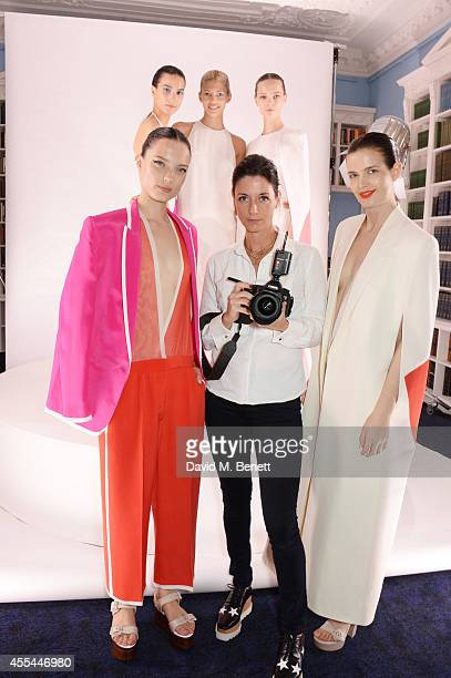 Mary McCartney poses with models at The London 2014 Stella McCartney Green Carpet Collection during London Fashion Week at The Royal British...