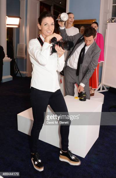 Mary McCartney takes photographs at The London 2014 Stella McCartney Green Carpet Collection during London Fashion Week at The Royal British...