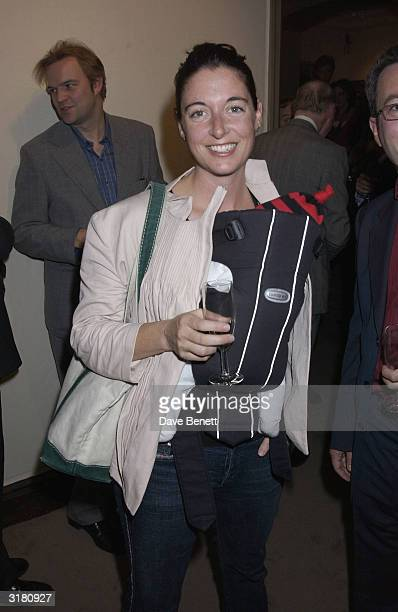 Mary McCartney with her new baby at the private viewing of Ex Clash bass guitarist Paul Simonon's new exhibition Scenes of London at the...