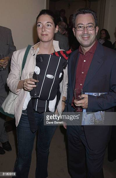 Mary McCartney with her new baby with Comedian Ben Elton at the private viewing of Ex Clash bass guitarist Paul Simonon's new exhibition Scenes of...