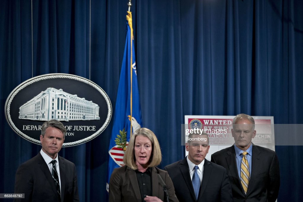 Mary McCord, acting U.S. assistant attorney general for national security, center, speaks as Brian Stretch, U.S. attorney for the northern district of California, from left, Paul Abbate, executive assistant director of the Federal Bureau of Investigation (FBI) criminal, cyber, response and services branch, and Vaughn Ary, director of the Justice Departments office of international affairs, listen during a news conference at the Department of Justice in Washington, D.C., U.S., on Wednesday, March 15, 2017. The U.S. charged four people, including two Russian intelligence officers, over the theft of hundreds of millions of accounts of Yahoo Inc. users from a computer breach that threatened to derail its acquisition by Verizon Communications Inc. Photographer: Andrew Harrer/Bloomberg via Getty Images