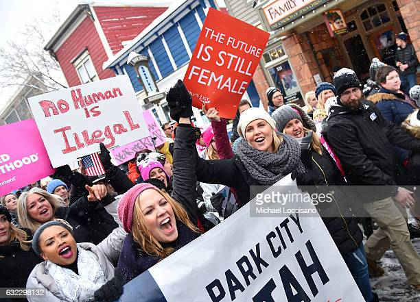 Mary McCormack and Charlize Theron pose during the Women's March on Main Street Park City on January 21 2017 in Park City Utah