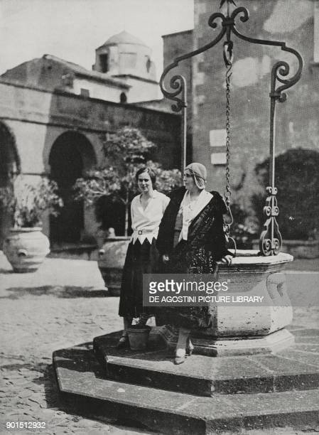 Mary of SaxeCoburg and Gotha Queen consort of Romania and her daughter Ileana princess of Romania in the courtyard of Sangallo Fort Nettuno Italy...