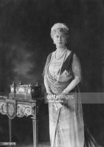 Mary of Teck , Queen Consort of King George V, wearing the Star of the Order of the Garter and holding a fan, circa 1926.