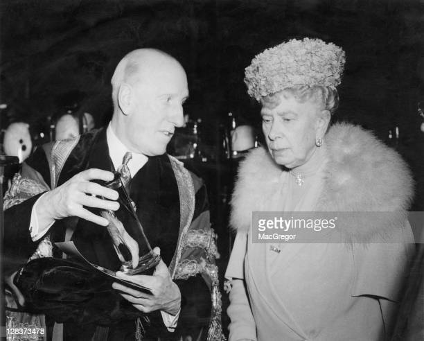 Mary of Teck Queen Consort of King George V with surgeon Sir Alfred WebbJohnson 1st Baronet WebbJohnson during a visit to the Royal College of...