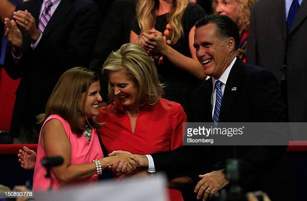 Mary Pat Christie wife of New Jersey Governor Chris Christie left greets Mitt Romney Republican presidential candidate right and wife Ann Romney at...