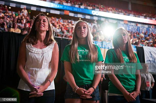 Mary Pawlenty wife of Republican presidential candidate Tim Pawlenty stand with their daughters Mara center and Anna while he addresses the crowd...