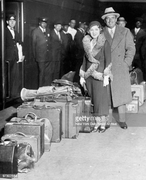 Mary Pickford and Douglas Fairbanks arrive at Grand Central Terminal.
