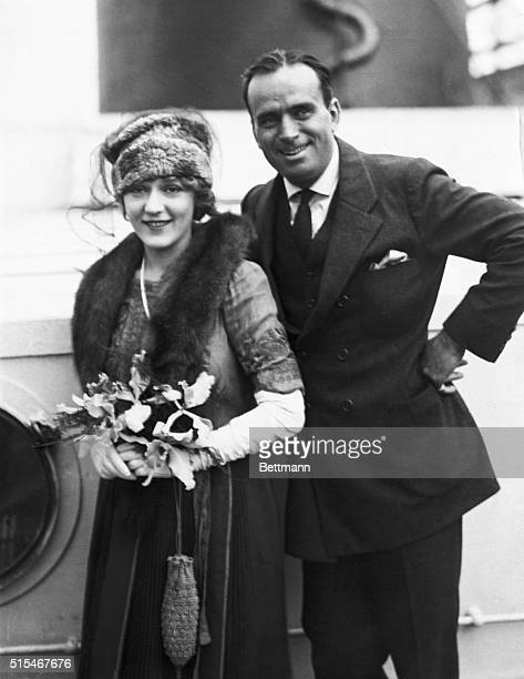 Mary Pickford and Douglas Fairbanks Posing on the deck of the ship taking them to the Laplands.