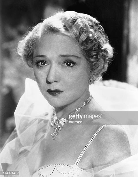 Mary Pickford is shown in a closeup portrait This is a publicity photo taken in 1953 when she was 60 years old to promote the sale of US Savings Bonds