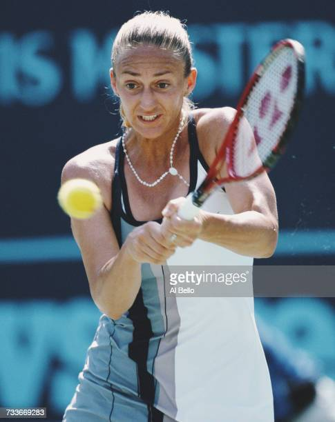 Mary Pierce of France makes a double backhand return against Martina Hingis during their Indian Wells Masters Women's Singles Semi Final match on 15...