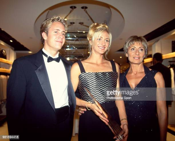 Mary Pierce of France poses with her brother David and mother Yannick at the 18th Annual Women's Tennis Association Awards Banquet on August 29 1994...