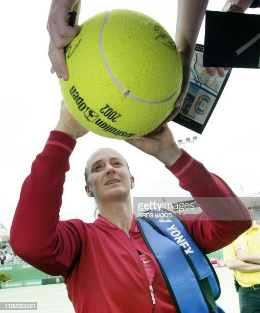 Mary Pierce of France signs a giant tennis ball following her victory over Patricia Wartusch of Austria in their first round women's singles match at...