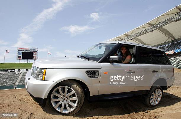 Mary Pierce of France takes a Range Rover on a dirt course at a press conference during the JP Morgan Chase Open at the Home Depot Center on August 8...