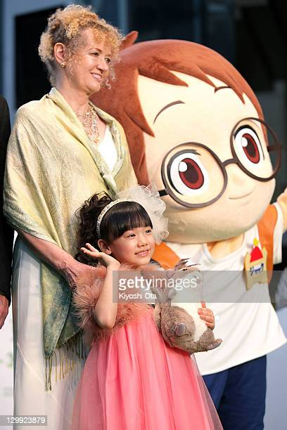 Mary Pope Osborne , original author of 'Magic Tree House' and actress Mana Ashida pose with its character Jack during the 24th Tokyo International...