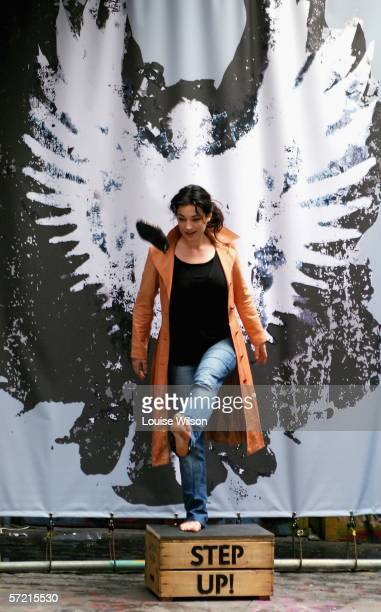 Mary Poppins star Laura Michelle Kelly poses with a sevenfoot angel figure at a photocall to launch the Global Angels charity's Step Up campaign...