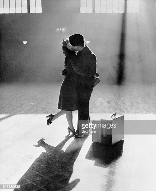 Mary Rae Bingham kisses her boyfriend Gordon Kiester in the sunshine from a window at Michigan Central Station in Detroit December 1944 Kiester is...