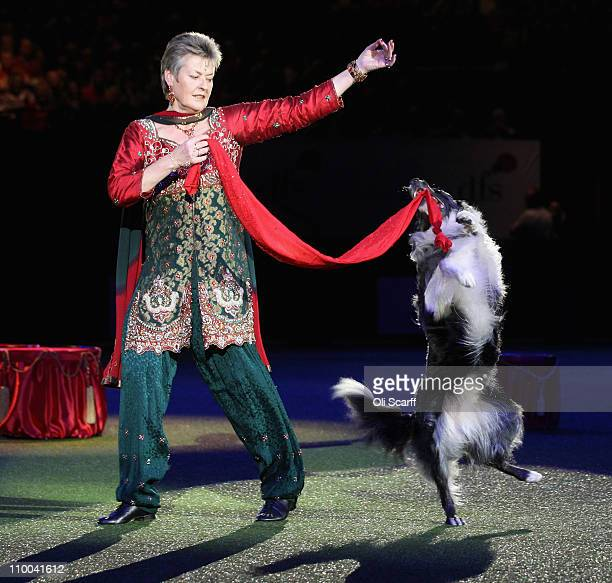 Mary Ray a dog trainer performs heelwork to music prior to the announcement of the 'Best in Show' at the 2011 Crufts dog show at the National...