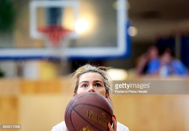 Mary Redmond of Old Orchard Beach focusses as she lines up a foul shot during the finals of the first Jim Sandler Memorial Foul Shooting Championship...