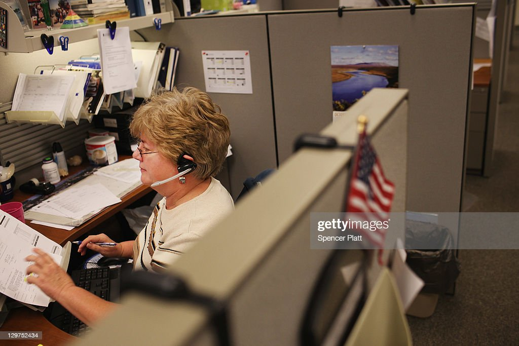 Mary Rehrer, an inside sales representative, works on the phone at Quadrant, a high end plastic manufacturer on October 19, 2011 in Reading, Pennsylvania. Quadrant, a 70 year old company, employs more than 2000 people in 20 countries and is one of the few remaining manufacturers in the area to still provide stable jobs in an uncertain economy. Reading, a city that once boasted numerous industries and the nation's largest railroad company, has recently been named America's poorest city with residents over 65,000. According to new census data, 41.3 percent of people live below the poverty line in Reading. Reading has about 90,000 residents, many of whom are recent Hispanic arrivals who have moved from larger eastern cities over the past decade. While a manufacturing base offering well paying jobs still exists in Reading, many companies like Hershey, Stanley Tool and Dana Systems have either moved elsewhere in the United States or to Mexico in search of cheaper labor. The number of people living in poverty in America, 46.2 million, is now at its highest level for the 52 years the Census Bureau has been keeping records.