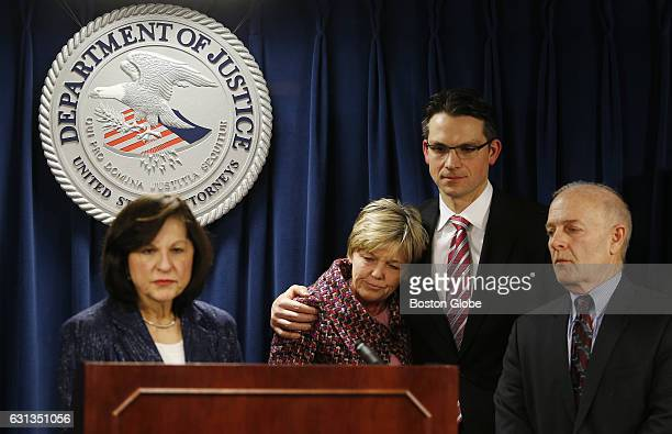 Mary Rizzo center the mother of Jonathan Rizzo who was murdered by Gary Lee Sampson is embraced by Prosecutor Zachary Hafer second from right as US...