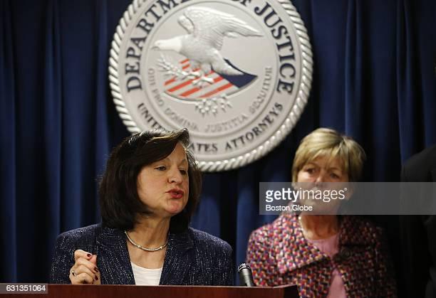 Mary Rizzo right the mother of Jonathan Rizzo who was murdered by Gary Lee Sampson looks on as US District Attorney Carmen Ortiz addresses reporters...