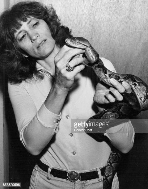 Mary Rollins with reticulated python named 'Houdini' Credit Denver Post