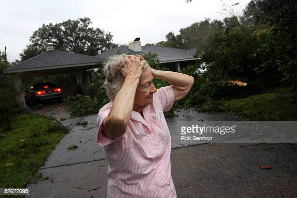 Mary Scheps surveys the damage to her home after Hurricane Gustav passed through September 1, 2008 in Lafayette, Louisiana. The intensity of...