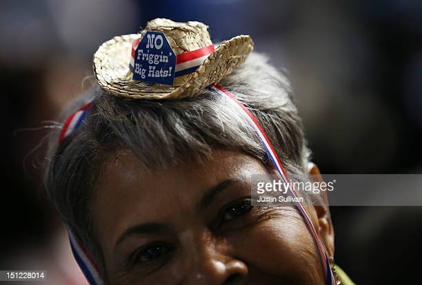 """Mary Seymore wears a tiny hat that reads """"No Friggin' Big Hats!"""" during day one of the Democratic National Convention at Time Warner Cable Arena on..."""